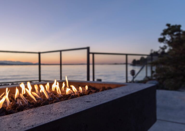backyard golden hour sunset gas lit fire pit by wa FW5ABHW | Design & Installation Services
