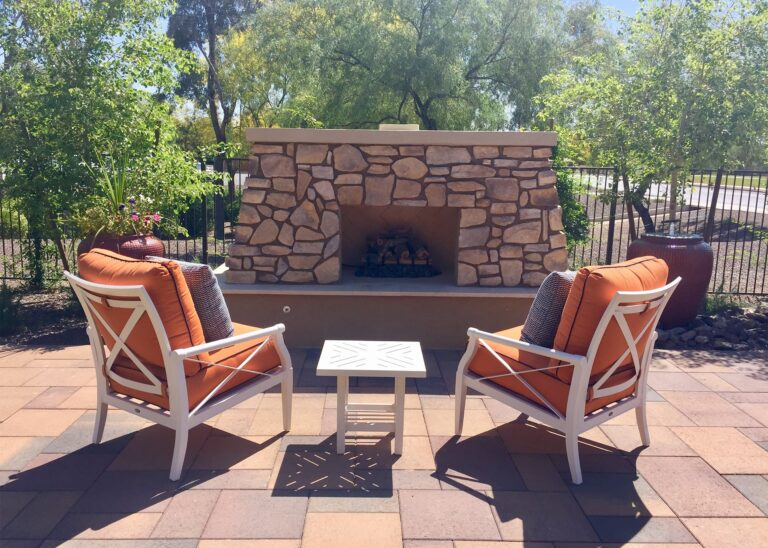 outdoor fireplace and chairs on a patio MSL2NJL 5X7 | Design & Installation Services